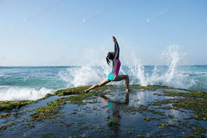 Powerful woman yoga on seaside