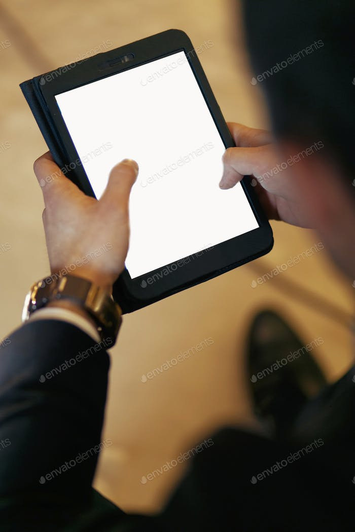 stylish man holding tablet with empty white screen and touching