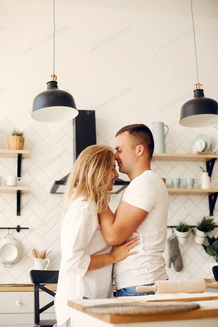 Beautiful couple prepare food in a kitchen