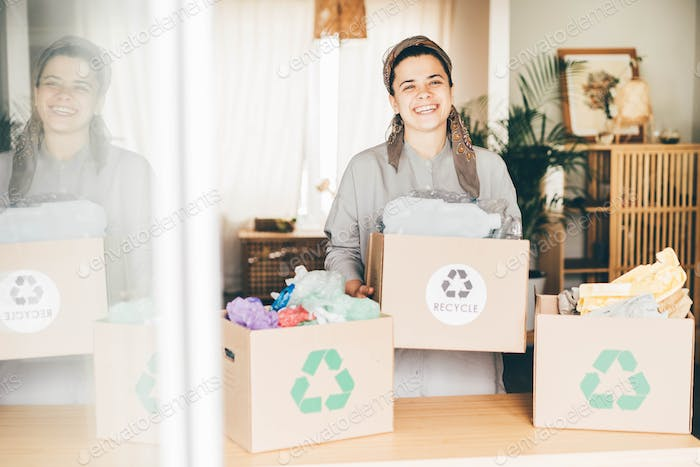 Woman sorting different waste.