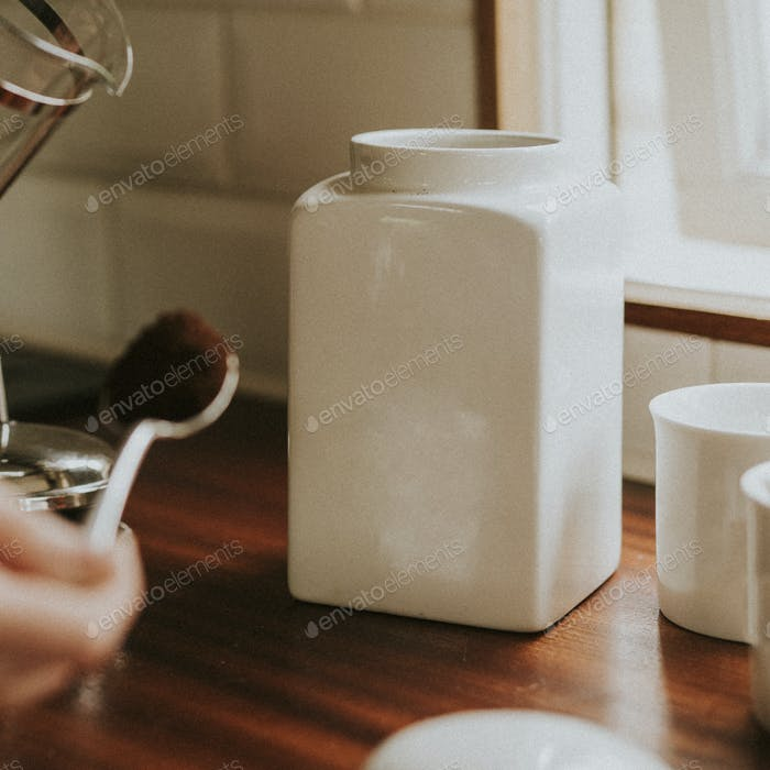Coffee white porcelain jars on kitchen counter