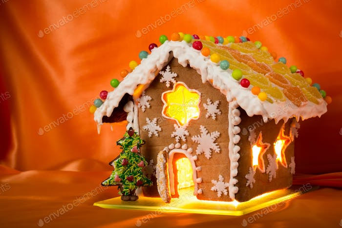 Christmas glazed gingerbread house with sweet pine.