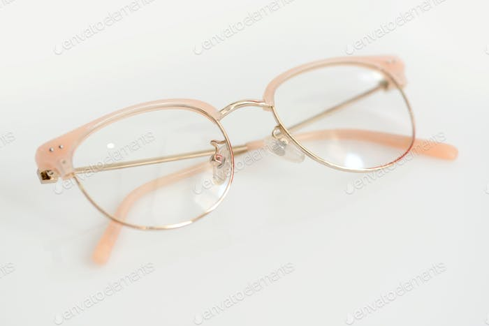 Pink glasses with clear lenses on the white background