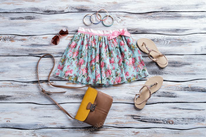 Floral skirt and aviator sunglasses.