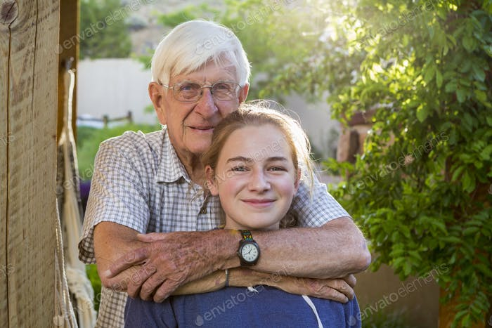 portrait of 13 year old girl and her 83 year old grandfather
