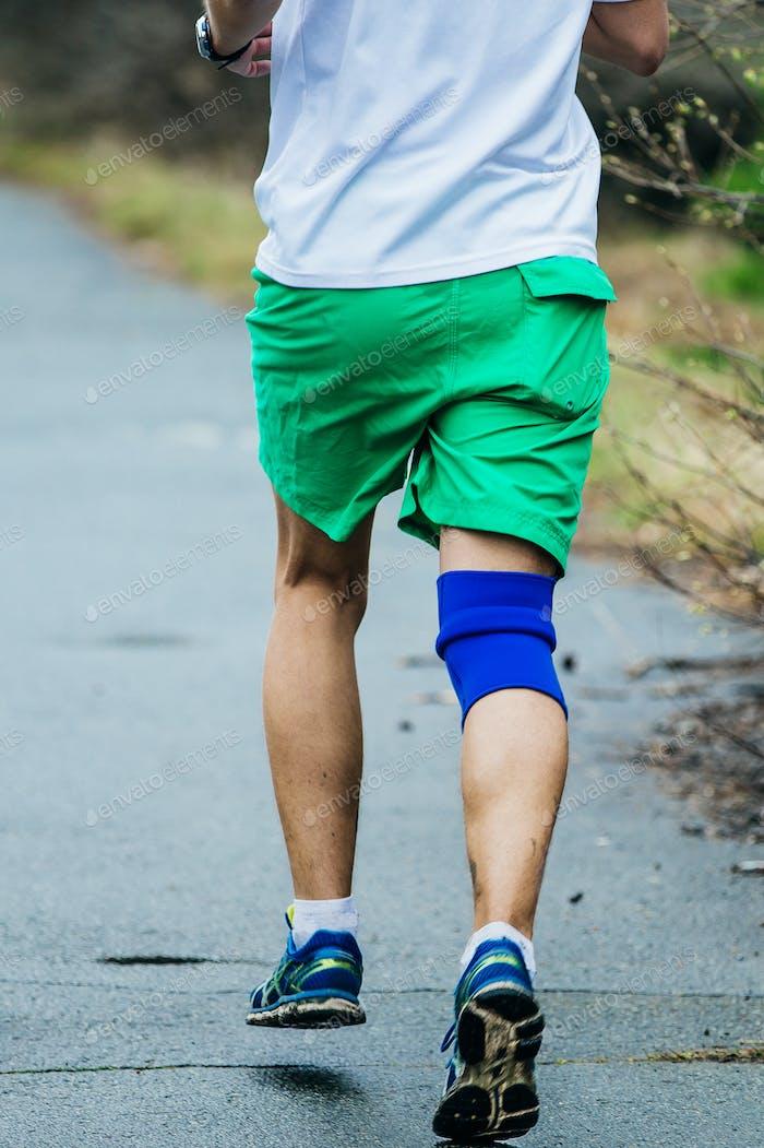 Athlete Man Running Road in Park