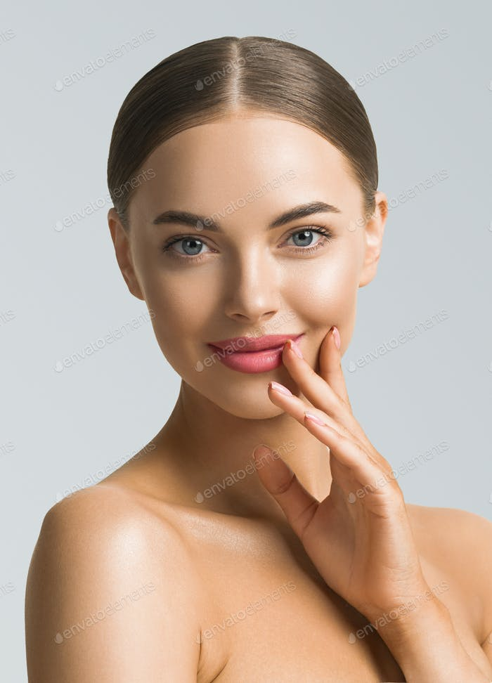 Beauty woman skin care beautiful female hand touching face cosmetic girl model over blue