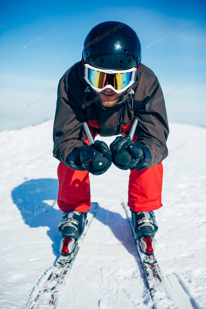 Skier racing from the mountain, front view
