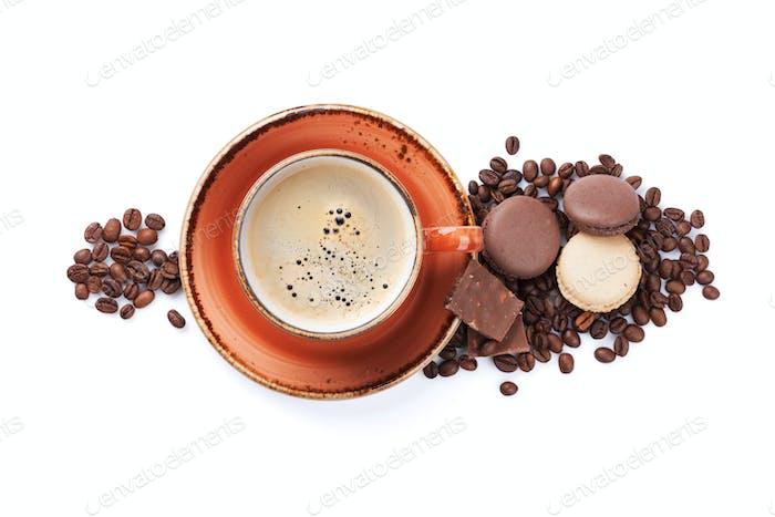 Coffee cup, chocolate and macaroons