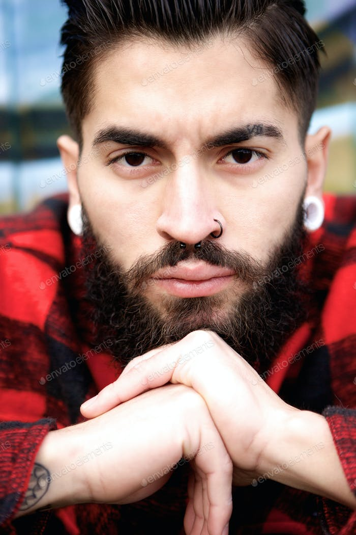 Young man with beard and piercing