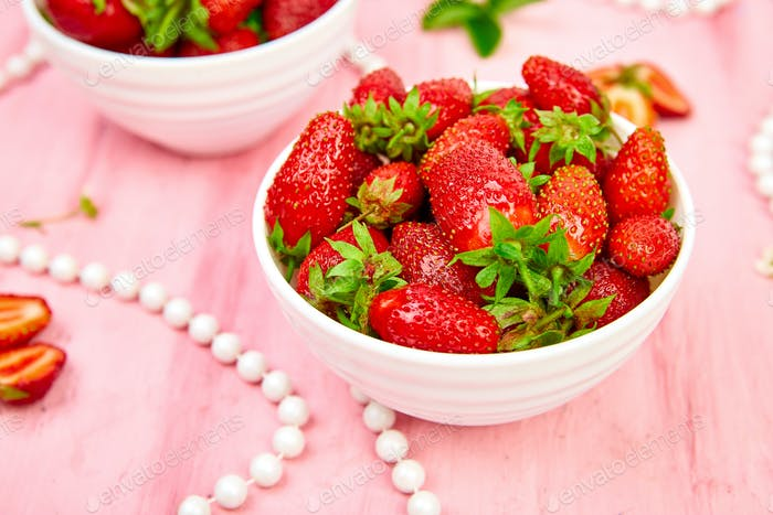 Strawberries in white bowl.