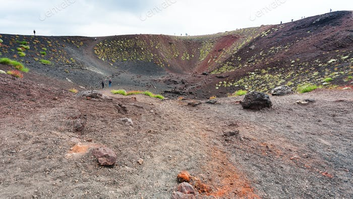 people in old crater on Mount Etna in Sicily