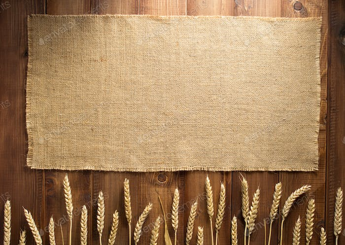 wheat grains on wooden background