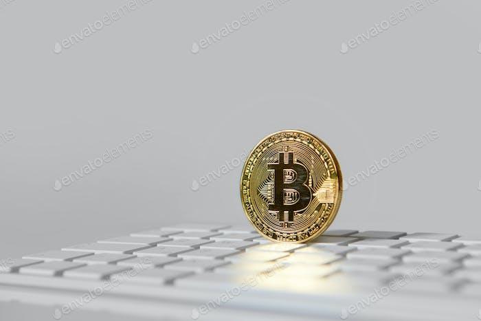 Bitcoin gold coin on keybord