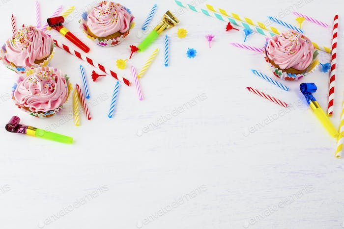 Birthday background with cupcakes and candles