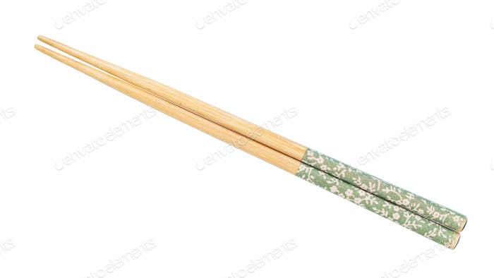 decorated wooden chopsticks put together isolated