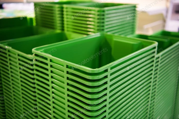 Green plastic home containers tower at store