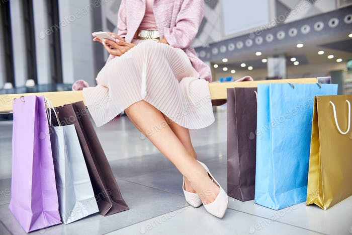 Elegant Woman with Shopping Bags