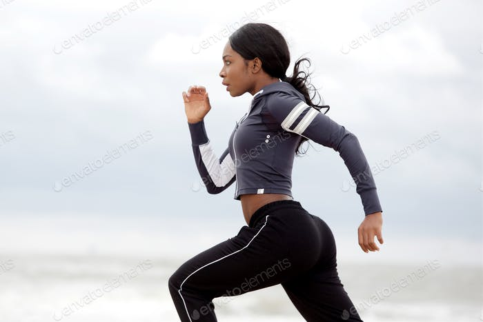 sporty young black woman running