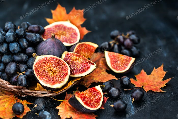 Autumnal fresh ripe figs and purple grape