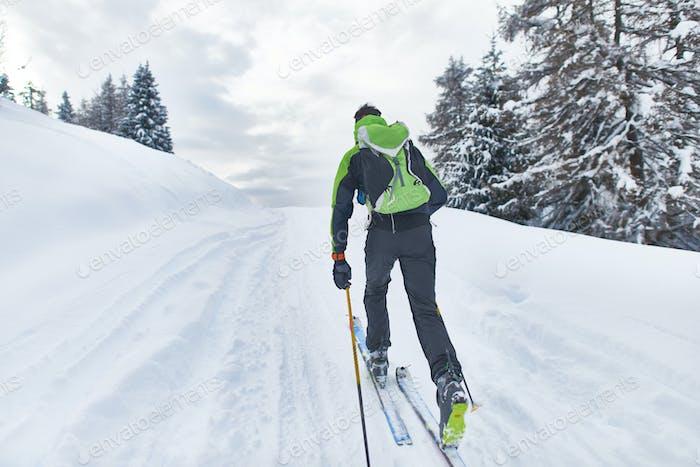 A hiker skier