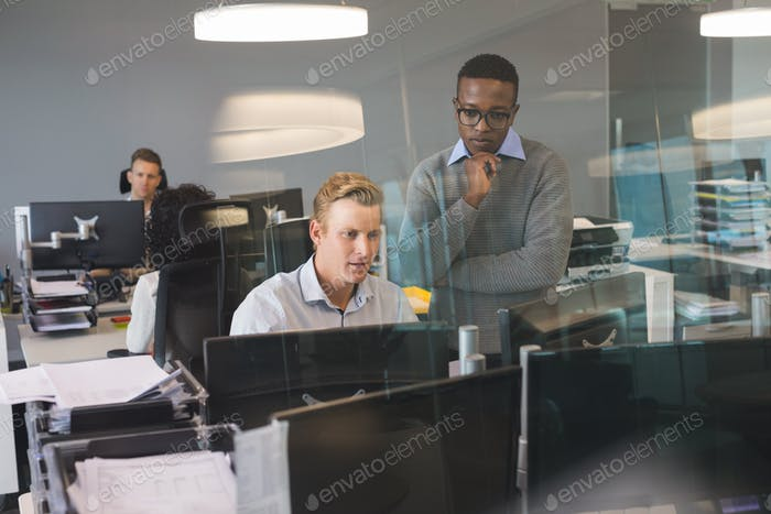 Focused business colleagues working at desk