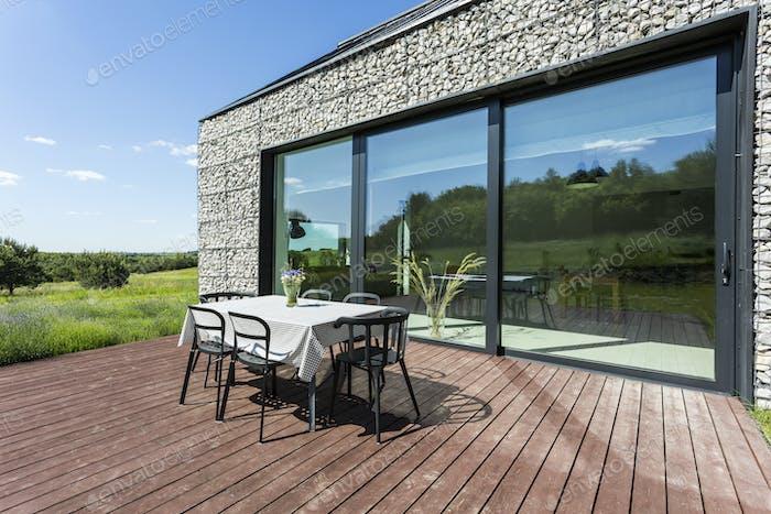 Villa patio with stone walls