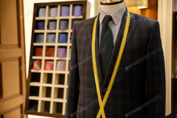 Photo of men suit jackets on hanger