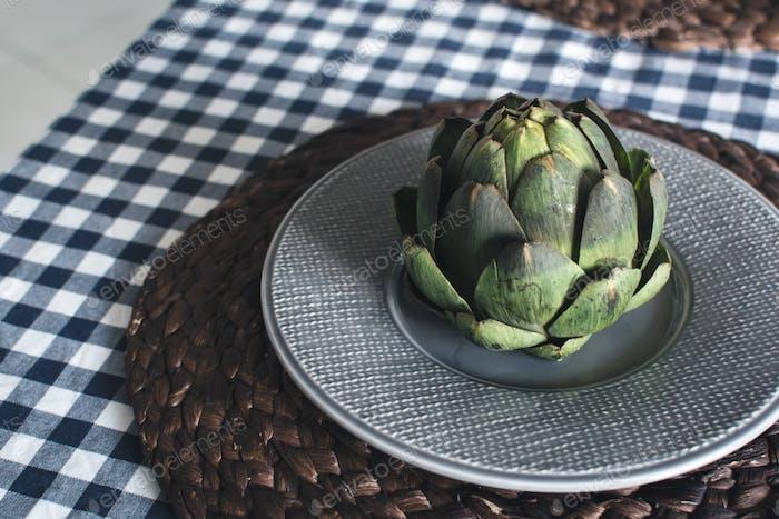 Artichoke on grey plate