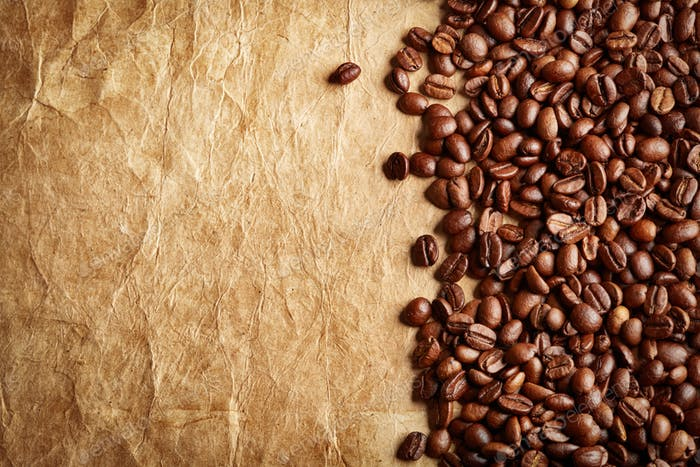 roasted coffee beans on antique paper