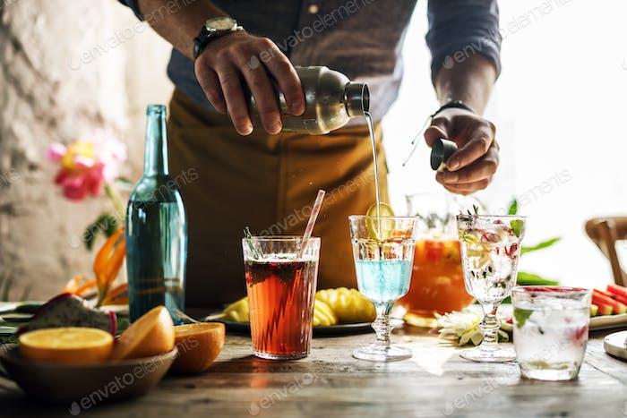 Bartender guy working prepare cocktail skills