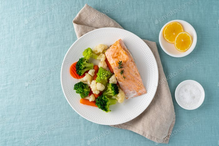 Steam salmon and vegetables, keto diet. Mediterranean food with steamed fish