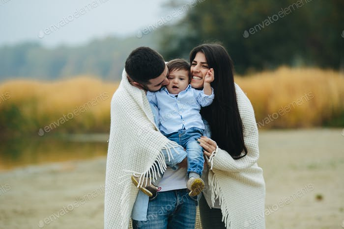 Young family together in nature with a little boy