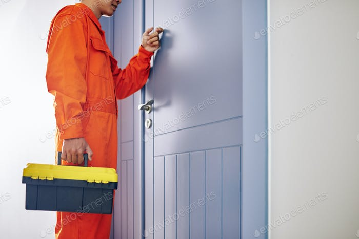 Handyman knocking on door