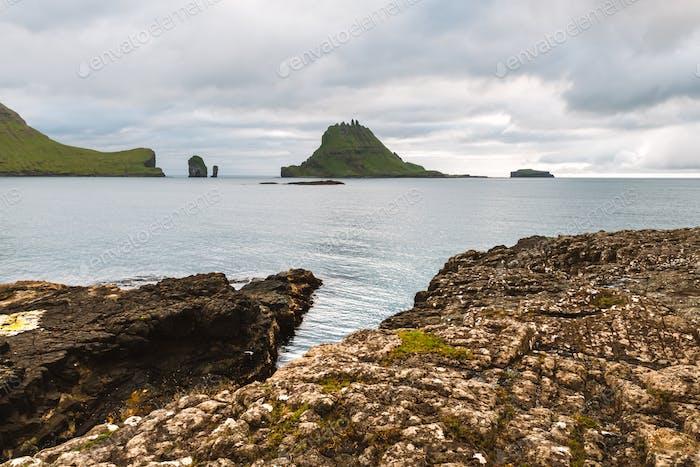 Dramatic view on Drangarnir and Tindholmur sea stacks