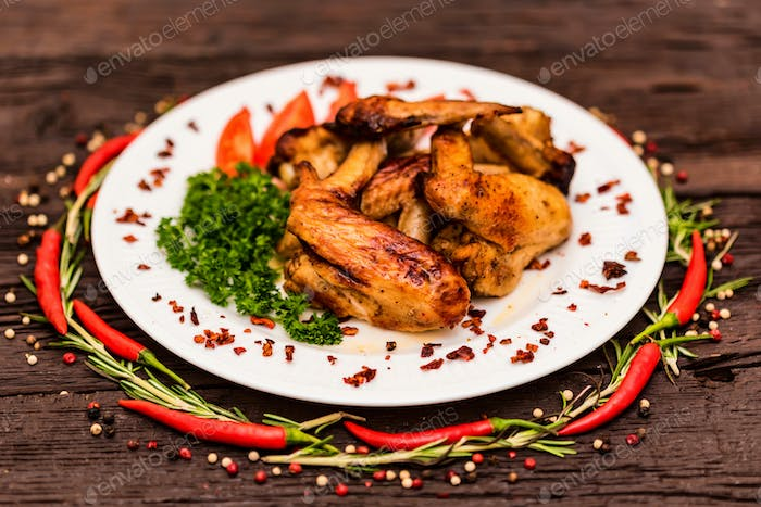 Chicken wings grilled with spices and chili pepper