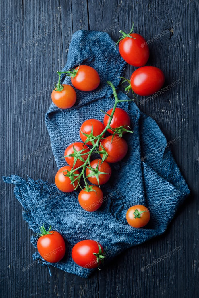 Cherry tomatoes over blue cloth