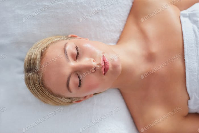 Beautiful woman relaxing on a massage table