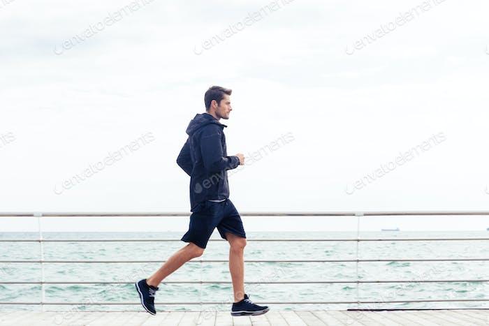 Sports man running outdoors