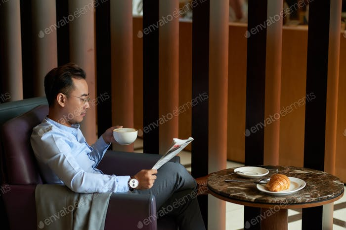 Businessman enjoying morning in cafe