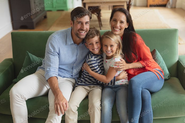 Portrait of Caucasian family sitting together on sofa in living room art home