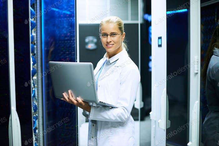 Female Scientist Working with Supercomputer