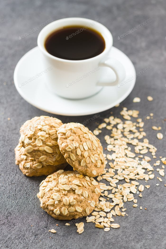 Healthy oatmeal cookies and cup of coffee.
