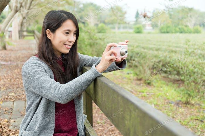 Woman using the digital camera