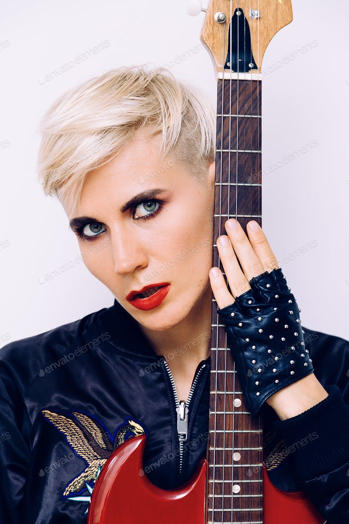 Sensual Blonde Girl with electro guitar. Rock style