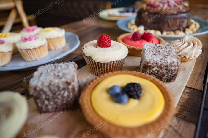 Close up of sweet food served in plate on wooden table