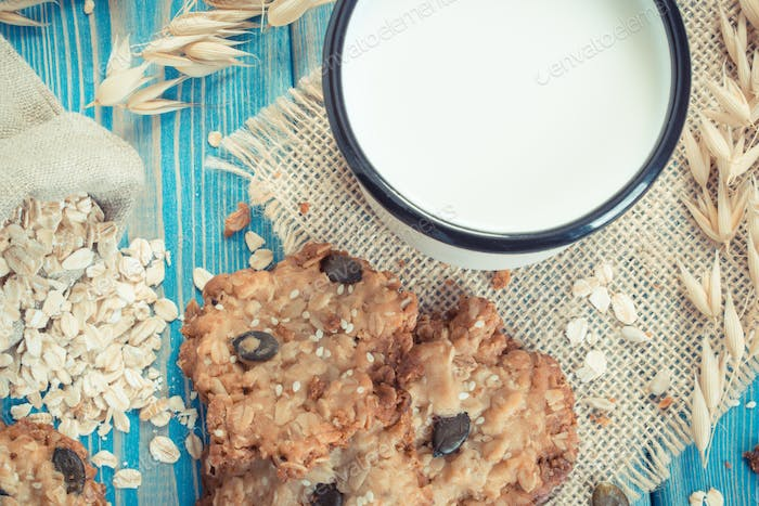 Vintage photo, Oatmeal cookies, ingredients for baking and ears of oat, healthy dessert concept