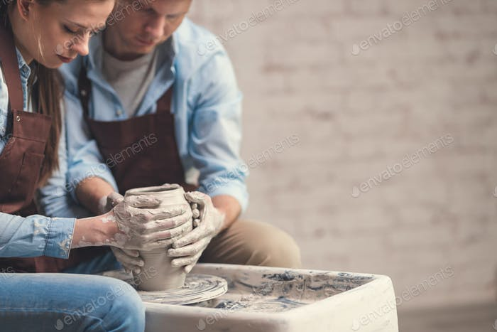 Young couple at the potter's wheel