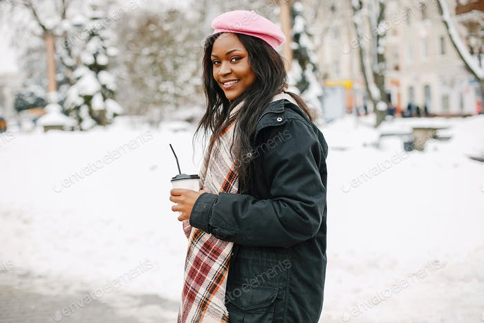 Thumbnail for Elegant black girl in a winter city