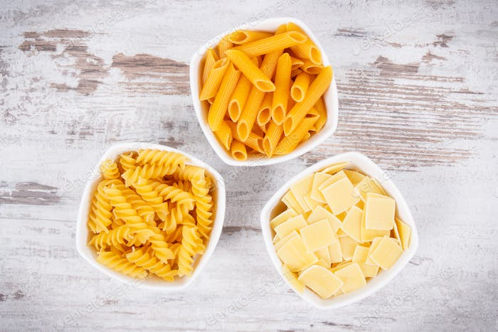 Various mix pasta in bowls as source carbohydrates and fiber